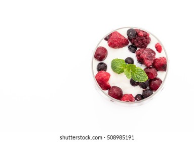 yogurt with mixed berries on white background