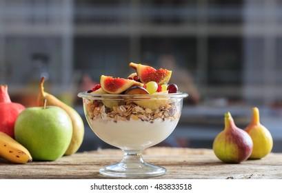 Yogurt, muesli and fresh fruits in a bowl