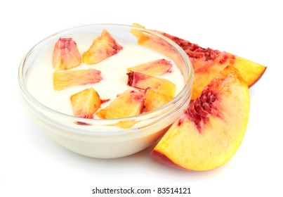 Yogurt with peach segments on a white background