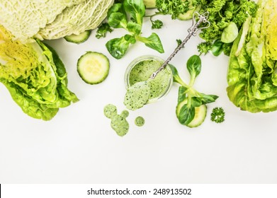 Yogurt smoothie  with green vegetables , food background, top view, frame