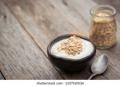 Yogurt. Stone bowl with fresh greek yogurt on wooden table