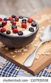 Yogurt. Stone bowl with fresh greek yogurt and berries