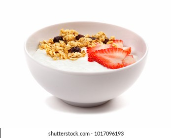 Yogurt with strawberries and granola in a white bowl. Side view, isolated on a white background.