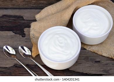 Yogurt  In white glass wood background.