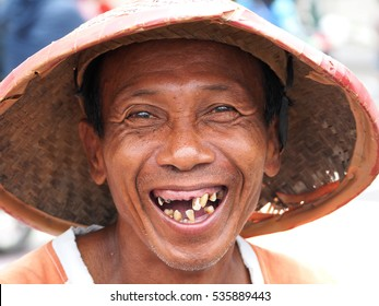 YOGYACARTA, JAVA -FEBRUARY 02 2016: Local weathered faced man with missing teeth smiling in the Yogyacarta,Java indonesia