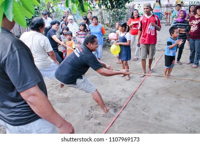 YOGYAKARTA 2016 - Group of man are playing a rope pull during independence day celebration in Yogyakarta
