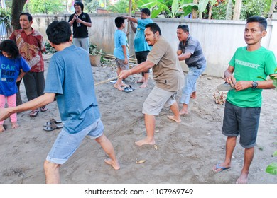 YOGYAKARTA 2016 - Men are having fun by join a rope pull competition during independence day celebration in Yogyakarta
