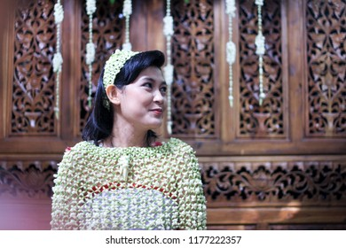 Yogyakarta 22 Oct 2012 - Beautiful asian girl is having siraman wedding ceremony accompany by her parents, she wear a traditional jasmine dress on her own