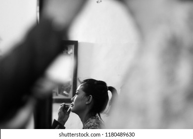 Yogyakarta 22 oct 2018 - Beautiful black and white portrait of asian girl who have early make up beforr her wedding ceremony begin, she will wear Indonesian wedding dress for whole day