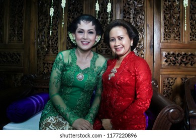 Yogyakarta 22 Oct 2018 - Girl in a Javanese kebaya dress is smiling during her wedding day accompany by her mother