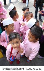 Yogyakarta 22 Oct 2018 - Moslem kindergarten kids are queuing before having an outdoor activities in a school outing program during summer day
