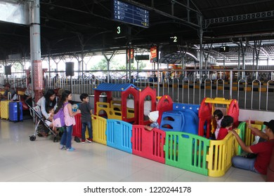 Yogyakarta 22 Oct 2018 - An officer placing a colorful kids corner and playground inside the railway station so every kid can play while waiting their train during sholiday