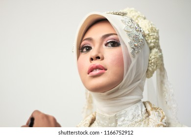 Yogyakarta 25 Sept 2018 - Beautiful girl wearing white moslem kebaya for her wedding that using traditional javanese ceremonial