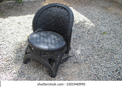 Yogyakarta 5 Sept 2019 - A local artost designing an outdoor chair that made from black truck used tire which got beautiful seat pattern during a furniture expo