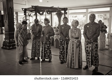 Yogyakarta 6 March 2017 - Group of people wearing traditional Javanese dress with surjan and batik fabric during wedding day celebration in vintage retro color
