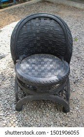 Yogyakarta 7 Sept 2019 - An artist is using old black tire to make a chair with beautiful seating pattern for outdoor garden during furniture expo