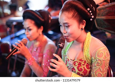 YOGYAKARTA APRIL 2014 - Beautiful lady with traditional Kebaya Javanese clothes are singing together during local wedding celebration in Gunung Kidul district of Yogyakarta