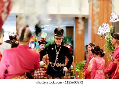 YOGYAKARTA APRIL 2015 - Bregodo Javanese guard is wearing black costume and bring a sword during traditional Javanese wedding ceremony in Yogyakarta
