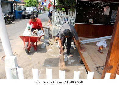 YOGYAKARTA AUGUST 10 - People are working together before indonesia independence day on August 17 by repairing fence and build local security substation in Yogyakarta Indonesia