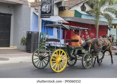 YOGYAKARTA, circa September 2014: colorful rickshaws on a street of Yogjakarta on September 2014. Becaks are traditional cycle rickshaws, popular with both locals and tourists.