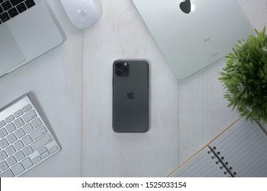 Yogyakarta, IDN - Oct 6, 2019 : iPhone 11 Pro mockup with office style background