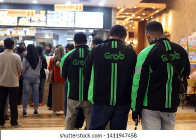 Yogyakarta, Indonesia - 05/29/2019 : Grab driver queues to order food. Grab is online transportation service.