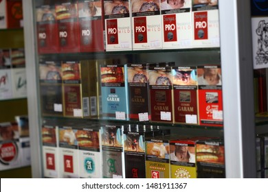 Yogyakarta, Indonesia - 08 18 2019 : various cigarette brands in the display case on the market in Indonesia.