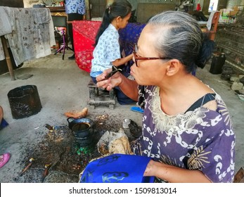 Yogyakarta, Indonesia - 09/20/2019 : The process of making traditional written batik which is a cultural heritage and batik is the original identity of Indonesia