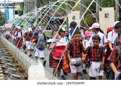 Yogyakarta, Indonesia - 10/18/2018 : Group of students walk under the water in Taman Pintar Yogyakarta