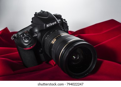 Yogyakarta, Indonesia - 14 January 2018: Nikon DSLR camera full frame body with zoom lens on a red cloth