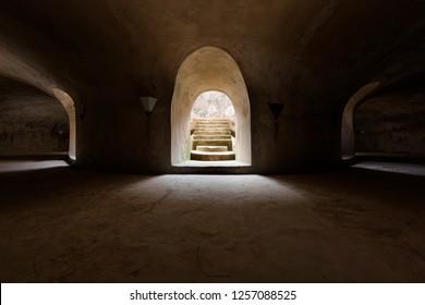 Yogyakarta, Indonesia - 17 Nov 2018: The underground level of the circular Sumur Gumuling mosque in Taman Sari palace complex, Yogyakarta, Indonesia.