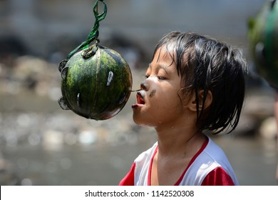 Yogyakarta, Indonesia, Indonesia 17th August 2017: Competition to take coins in watermelon is one of the celebrations to commemorate Indonesia's independence day
