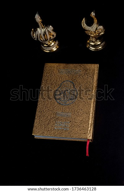 Yogyakarta, Indonesia - 20 May 2020: Al Quran view with golden cover design and Arabic souvenir