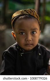 Yogyakarta, Indonesia - 22 January 2018 : Unidentified young Indonesian boy wearing the local school uniform heading to the school at Yogyakarta.