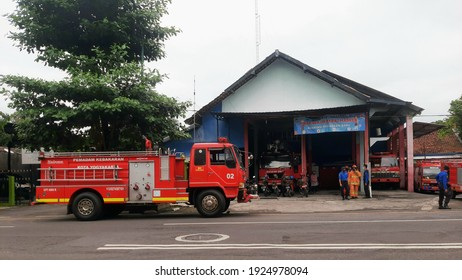 Yogyakarta, Indonesia - 24 February 2021: The atmosphere at the fire department headquarters. There is a fire truck parked by the side of the road.