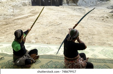 Yogyakarta, Indonesia, 29th October 2017. Two men who use blangkon are doing traditional archery practice.