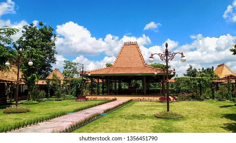 Yogyakarta / Indonesia - 31 March 2019 : Yogyakarta Joglo - Traditional house from central java with blue sky and green garden