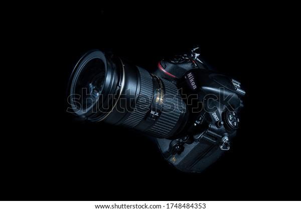 Yogyakarta, Indonesia - 4 June 2020: Nikon D800 DSLR camera levitation close up on dark background