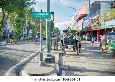 Yogyakarta - Indonesia. April 10, 2018: Malioboro street view with horse carriage and trishaw