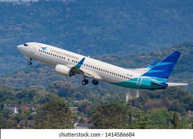 YOGYAKARTA, INDONESIA - APRIL 15, 2019 : A Garuda Indonesia Boeing 737-800 departing from Adisucipto Intl Airport in Yogyakarta. Garuda Indonesia is a national carrier of Indonesia.