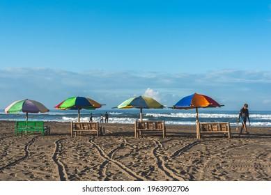Yogyakarta, Indonesia - April 24 2021 : umbrellas that are neatly arranged on the edge of Parangtritis beach