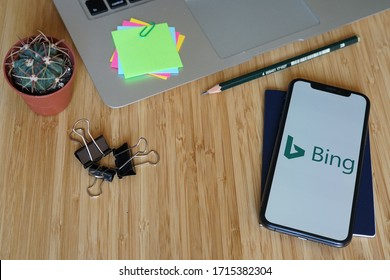 Yogyakarta, Indonesia - April 27, 2020; Bing Iphone Display with Macbook and Black Paper Clips. Bing is a web search engine owned and operated by Microsoft. #Bing