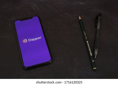 Yogyakarta, Indonesia - April 28, 2020; Dapper Iphone Display with Pencil on a Black Table. Dapper is an object-relational mapping product. Dapper