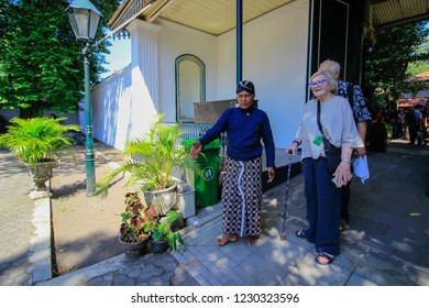 Yogyakarta, Indonesia - April 29th 2018 : Abdi dalem guiding foreign tourists entered the Palace of Yogyakarta, Kraton Yogyakarta Indonesia
