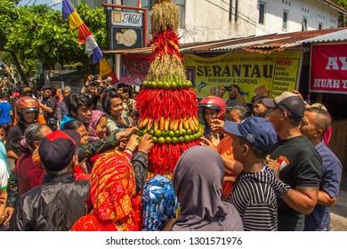 YOGYAKARTA, INDONESIA - April 29th 2018: People grab agriculture harvest at Gunungan Festival in Jogja, Indonesia