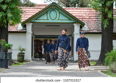"YOGYAKARTA, INDONESIA - AUGUST 10 2017: The ""Abdi dalem"" or servant of the sultan was chatting while walking in the palace of Yogyakarta"