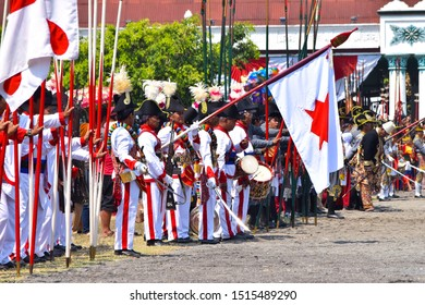 Yogyakarta, Indonesia - August 12th 2019 : Yogyakarta palace soldiers are walking follows the Gunungan Grebeg Besar which is a cultural tradition in the Palace of Yogyakarta, Indonesia.