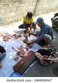 yogyakarta, INDONESIA AUGUST 14, 2019 :Indonesian Muslims help each other in preparing halal cow's meat after slaughtering during Eid Al-Adha Al Mubarak, the Feast of Sacrifice or Qurban