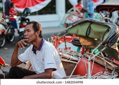 Yogyakarta, Indonesia. August 18, 2019. Becak driver is waiting for passenger. Sit on his pedicab in Malioboro street Jogja