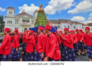 Yogyakarta, Indonesia - August 22th 2018 : Yogyakarta palace soldiers are lifting Gunungan Grebeg  Besar which is a cultural tradition in the Palace of Yogyakarta, Indonesia.